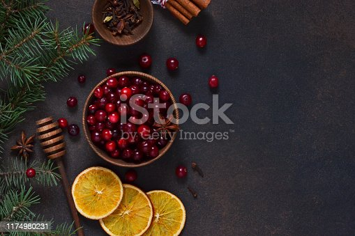 istock Xmas background. Ingredients for Christmas, winter baking cookies on a dark background . 1174980231