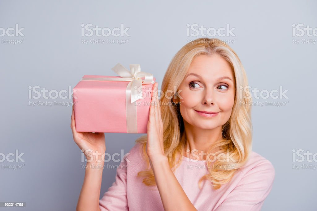 Xmas Christmas New Year unniversary win winner style trendy stylish people wife romantic person concept. Close up portrait of funky lovely cute glad grandmother giftbox isolated on gray background stock photo