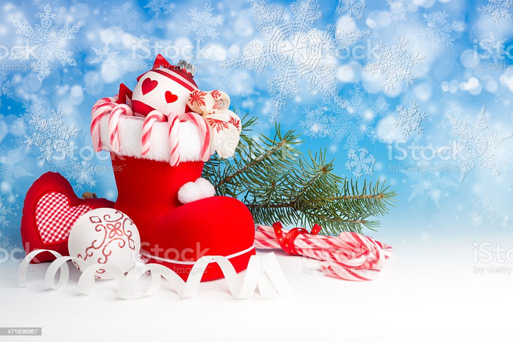 Xmas decorations and sweets on blue background royalty-free stock photo