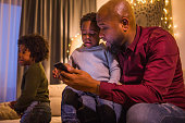 istock Xmas fun for beautiful Black father and sons at Christmas 1270202723