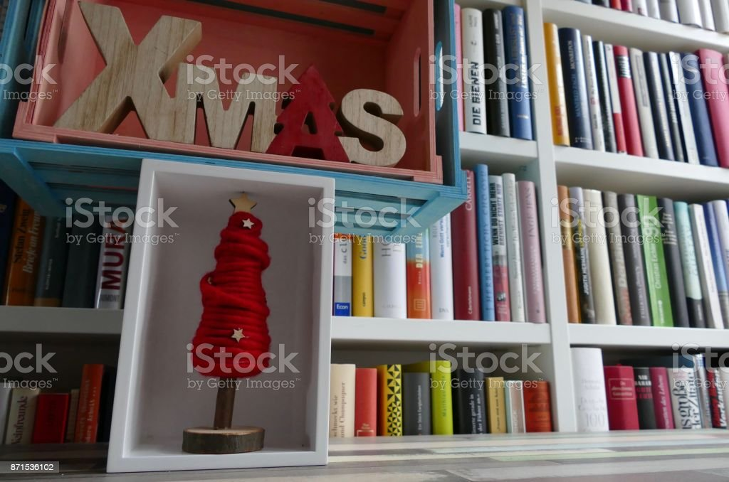 Xmas Letters And Tree Boxes In Front Of Book Shelves Royalty Free Stock Photo