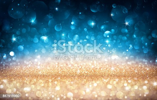 istock Xmas Shiny Background - Golden And Blue Bokeh 847915950
