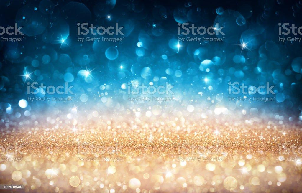 Xmas Shiny Background - Golden And Blue Bokeh stock photo