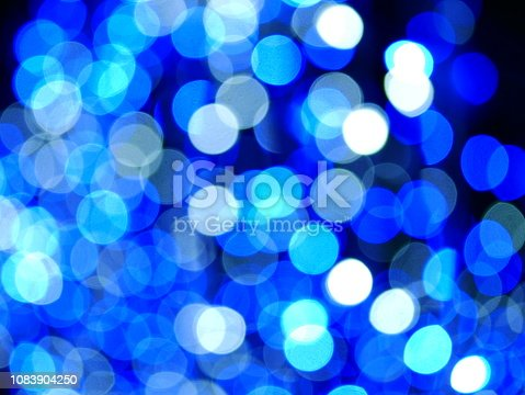 istock Xmas winter holiday blue background 1083904250