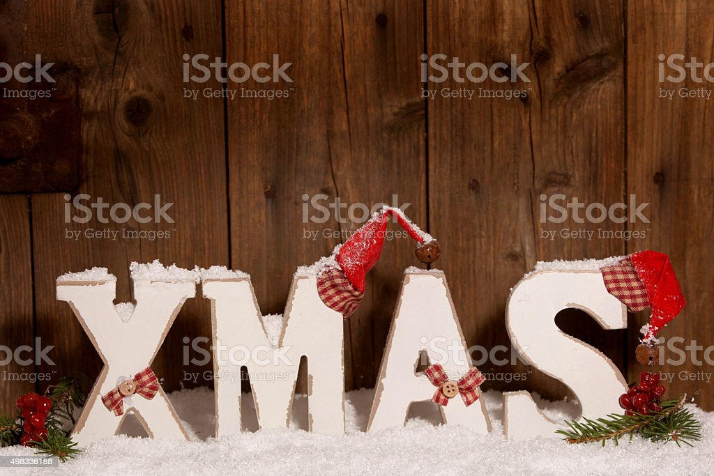 Xmas, Wooden letters with Christmas hats stock photo