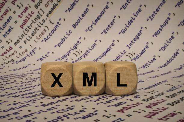 xml - cube with letters and words from the computer, software, internet categories, wooden cubes stock photo