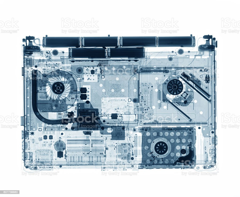 X-ray image of closed laptop on the table stock photo