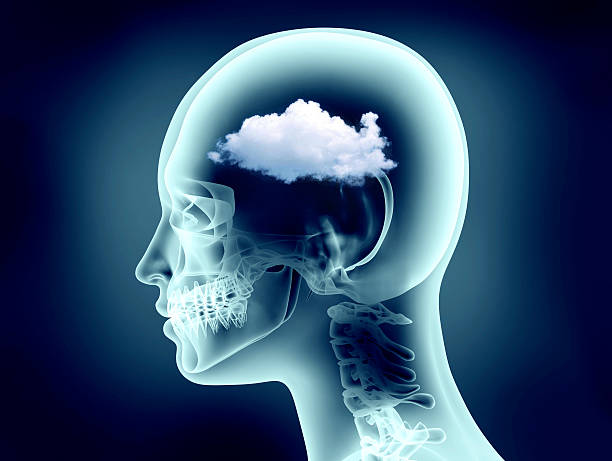 xray image of human head with clouds stock photo