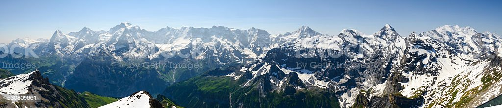 XXXL:Panoramic of the snow covered mountains of the Swiss Alps stock photo