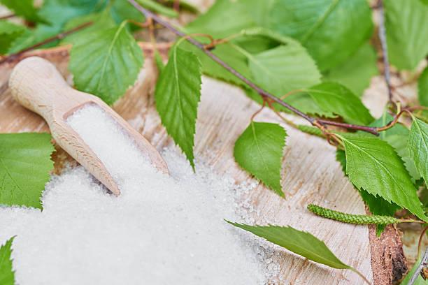 Xylitol birch sugar on a birch background stock photo