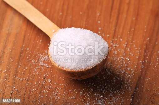 Xylitol birch sugar on wooden spoon