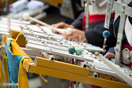 Xylophone executed by a young man in an independence parade, military march, demonstration of patriotism and love of the nation in Guatemala, central america.