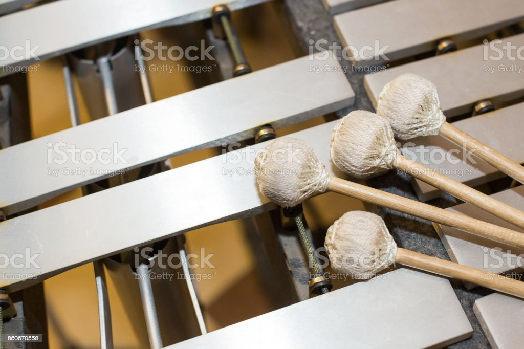 xylophone, music and chromatic instrument concept - closeup wooden bars with four mallets, glockenspiel, marimba, balafon, semantron, pixiphone, education and orchestra concert use, selective focus stock photo