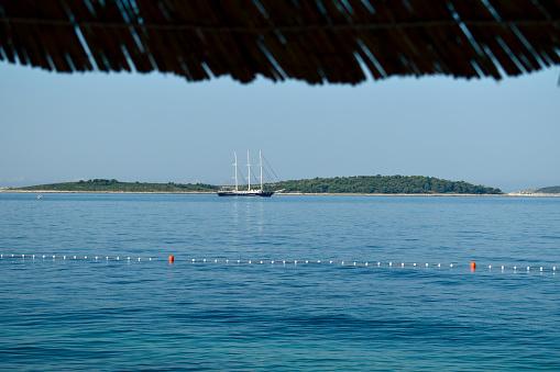 Sailing yacht at the horizon.