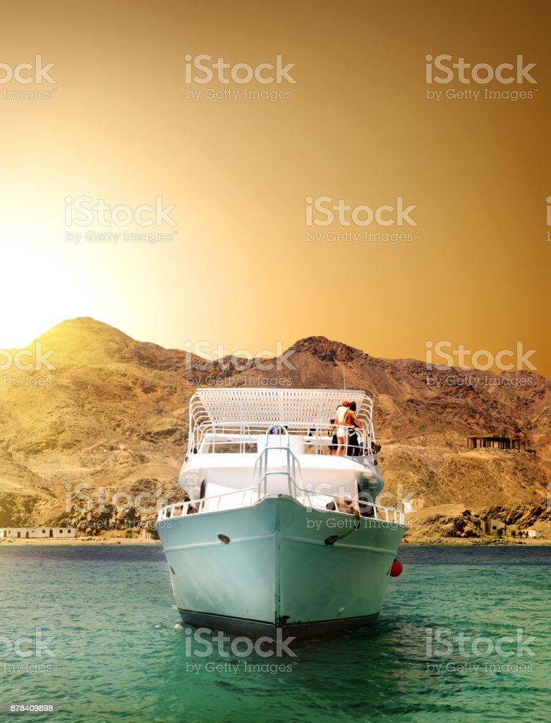 Yacht and mountain stock photo