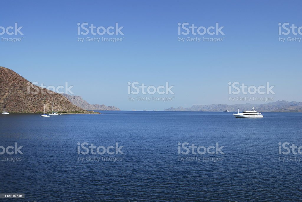 Yacht and Sailboats in bay royalty-free stock photo