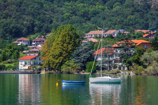 Yacht and small village on Lake Avigliana in Italy.