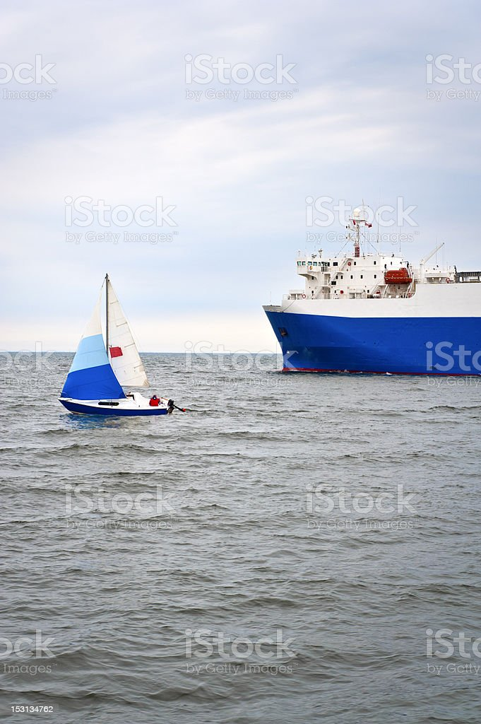 Yacht and trade ship stock photo