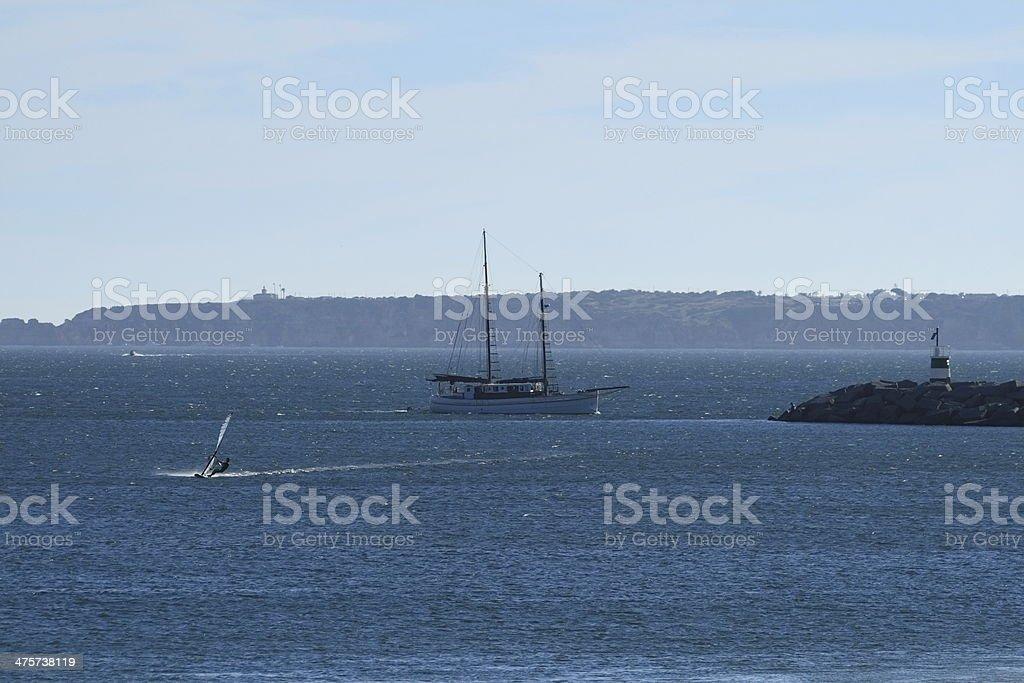 Yacht and Windsurfer royalty-free stock photo