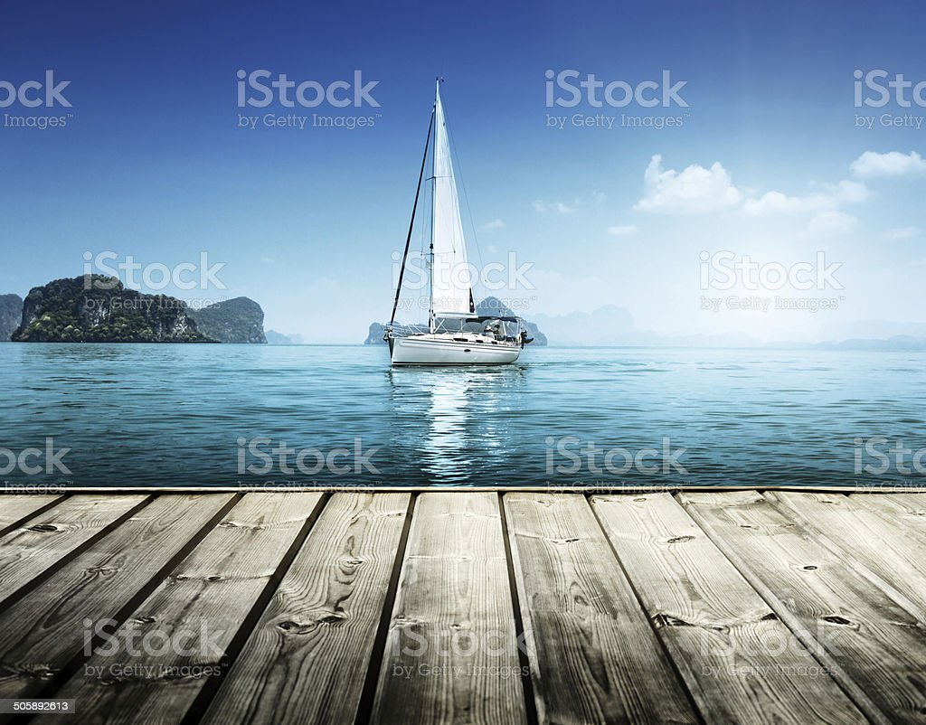 yacht and wooden platform stock photo