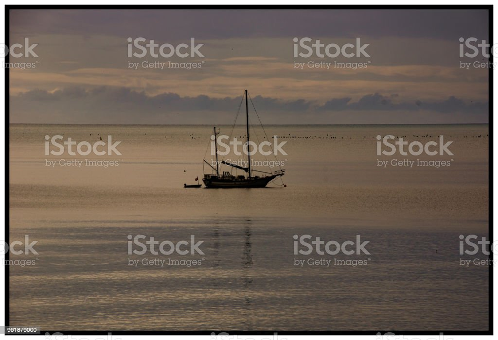 Yacht at anchor in St Austell Bay stock photo