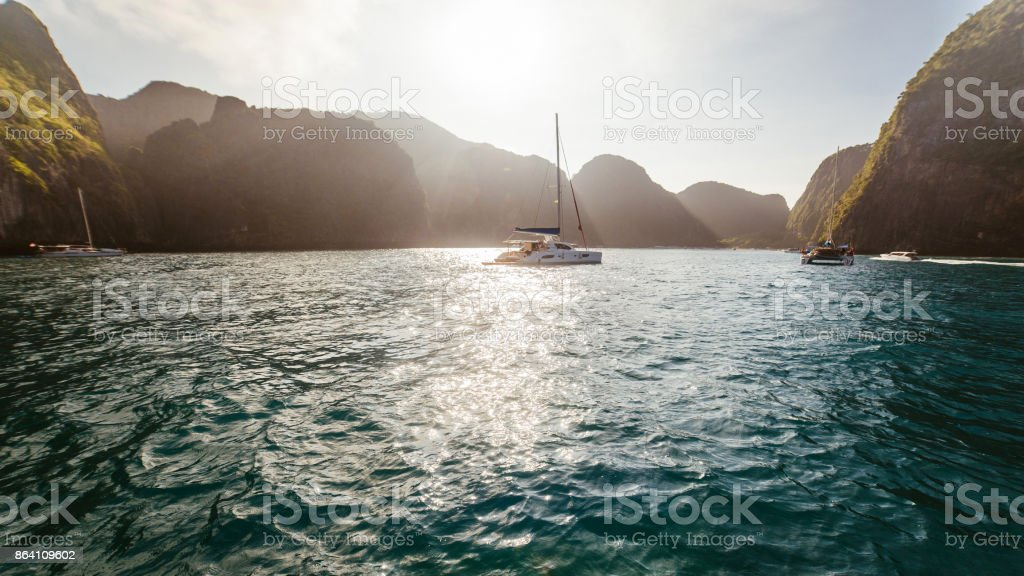 Yacht at sunrise royalty-free stock photo
