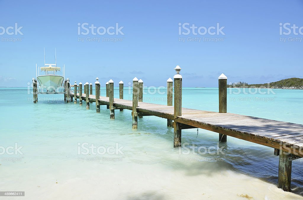 Yacht at the wooden jetty. Exuma, Bahamas stock photo