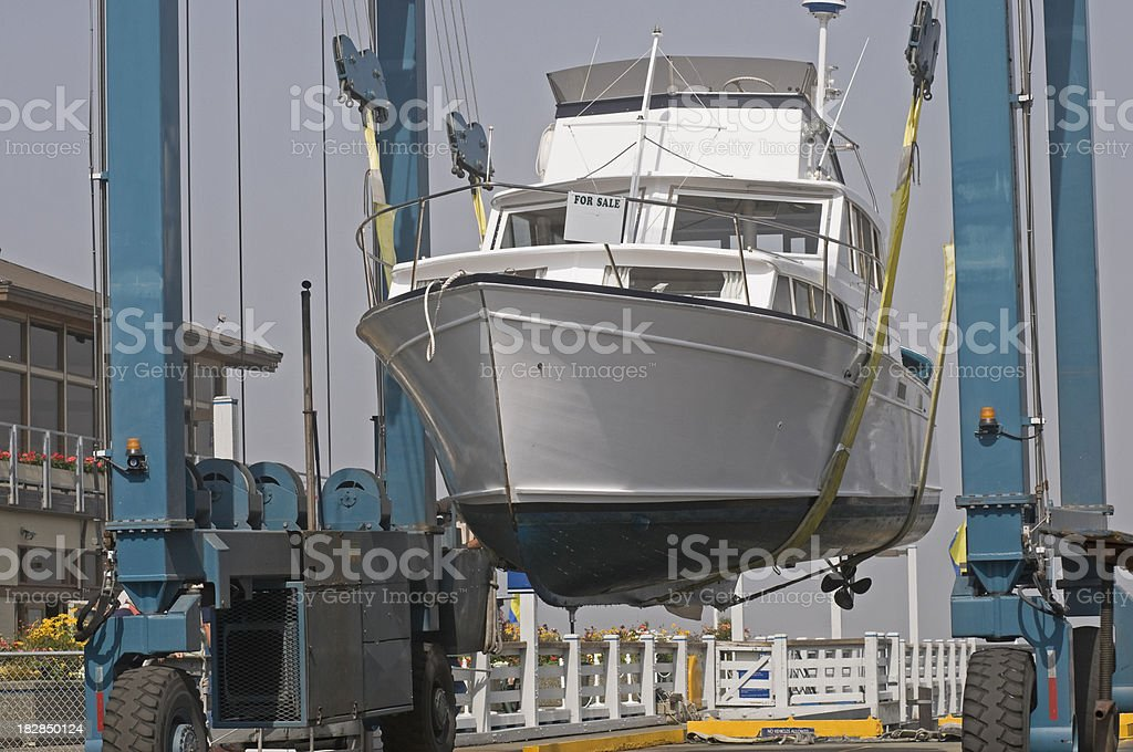 Yacht being lifted out of water stock photo
