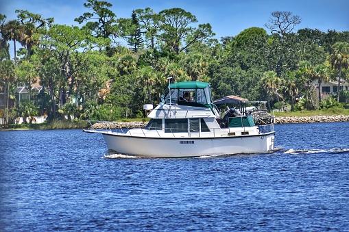 Yacht blue river island green trees