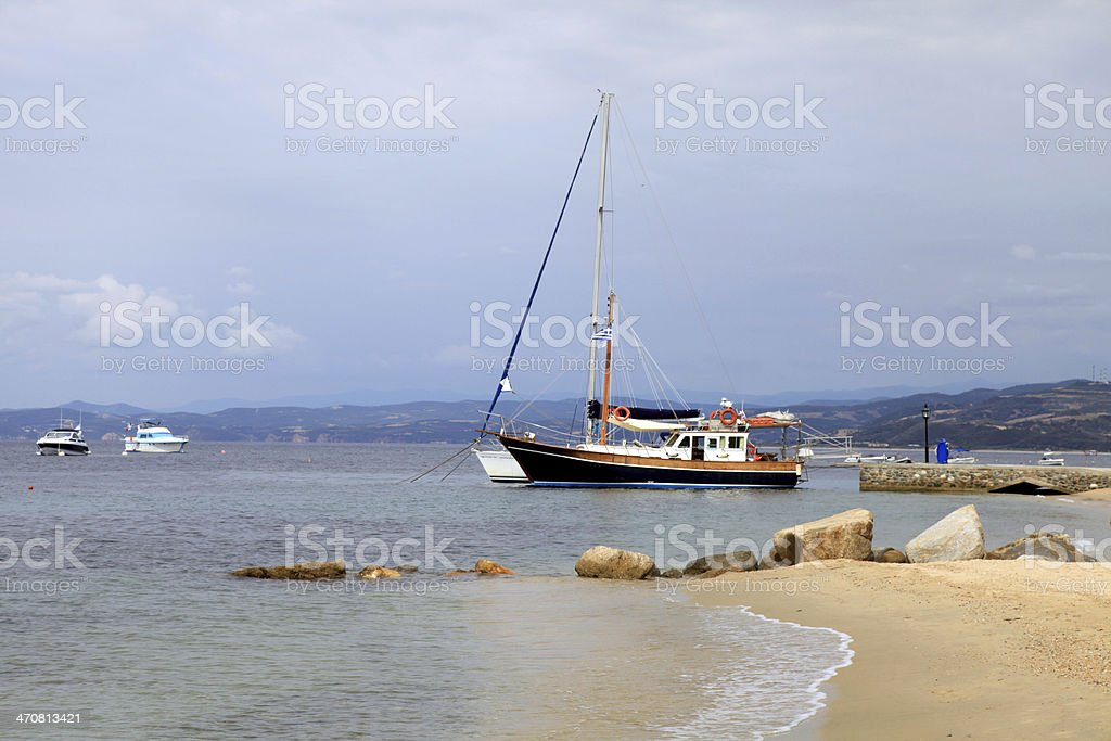 yacht boats, pier and sand beach,  Mediterranean Sea, Greece royalty-free stock photo