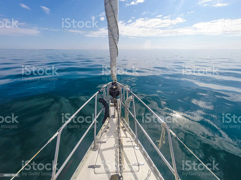 Yacht Bow on Calm Water in the Sun stock photo