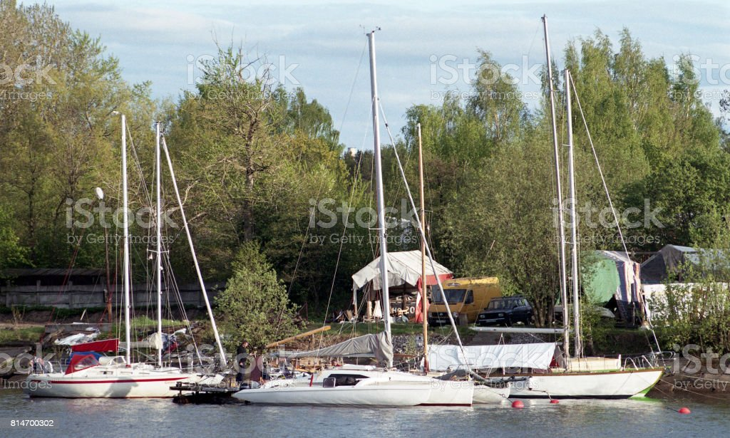 Yacht club and its inhabitants. Beautiful life and lifestyle of members of the yacht club stock photo