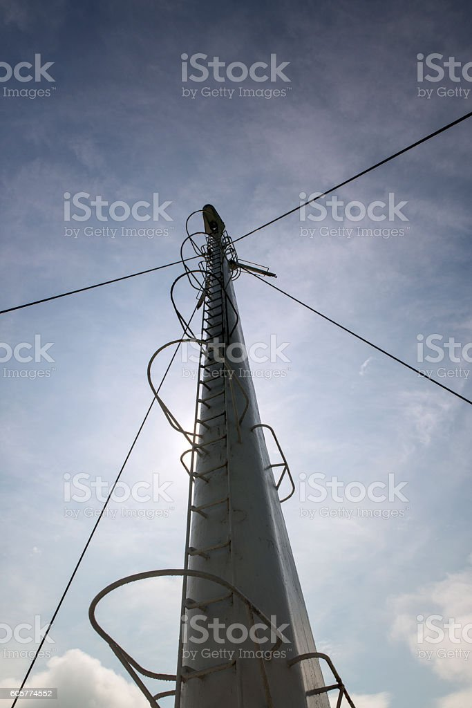 Yacht flagpole again blue sky stock photo