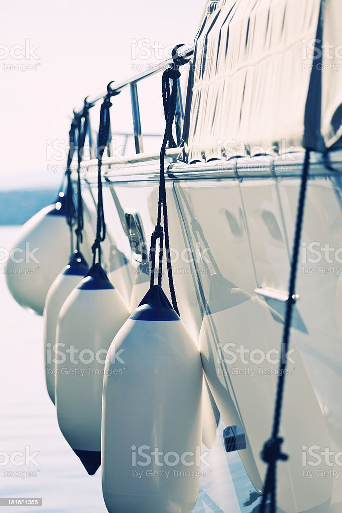 yacht flank fenders stock photo
