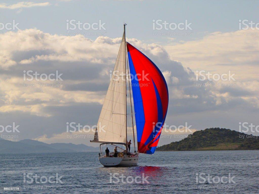 Yacht going under the genaker stock photo