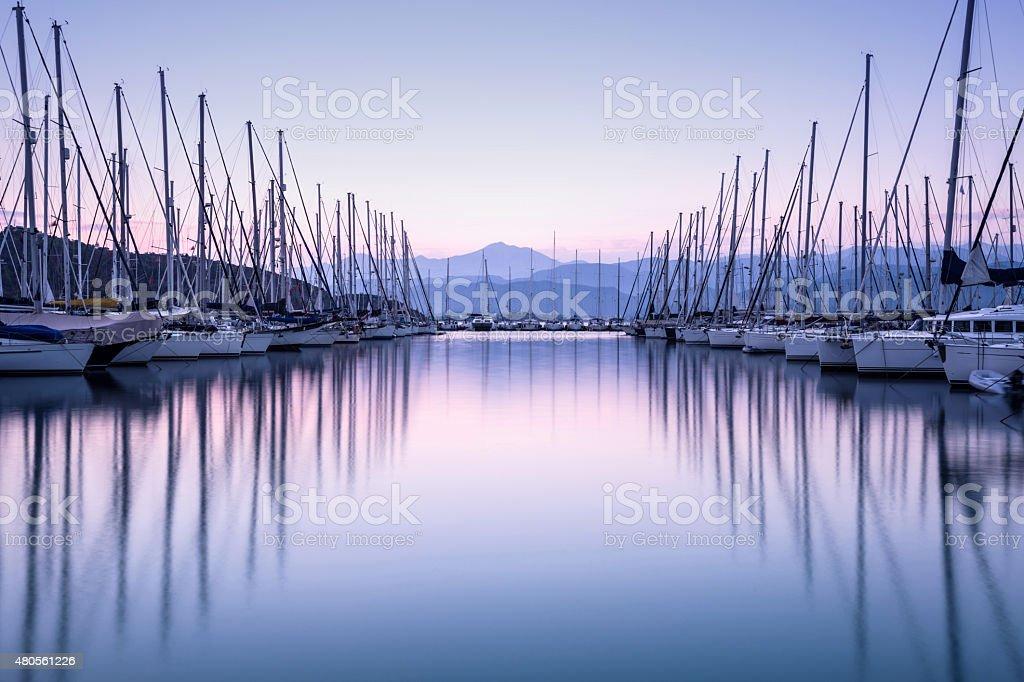 Yacht harbor in sunset stock photo