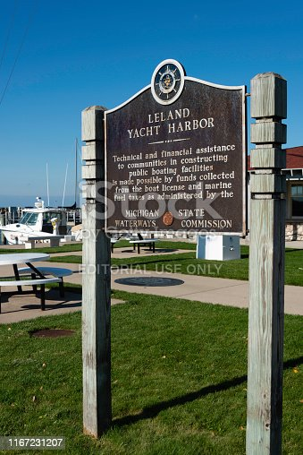 A sign gives info on the yacht harbor in the Leland Historic District (aka Fishtown) in Leland, Michigan, a small town on the Leelanau Peninsula outside Traverse City, Michigan. It is a very popular tourist destination.