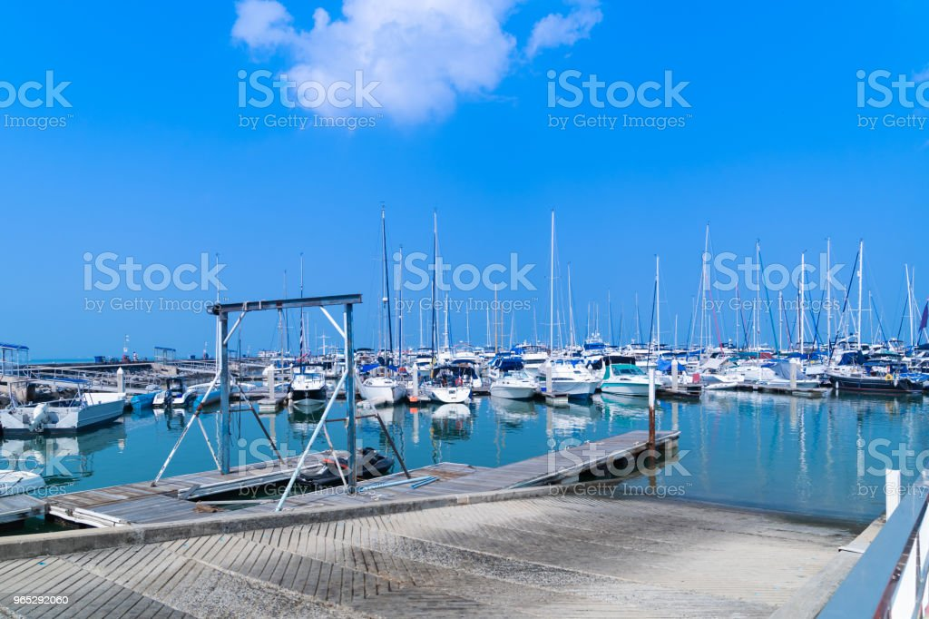 Yacht harbor on blue sky sunset light background. royalty-free stock photo