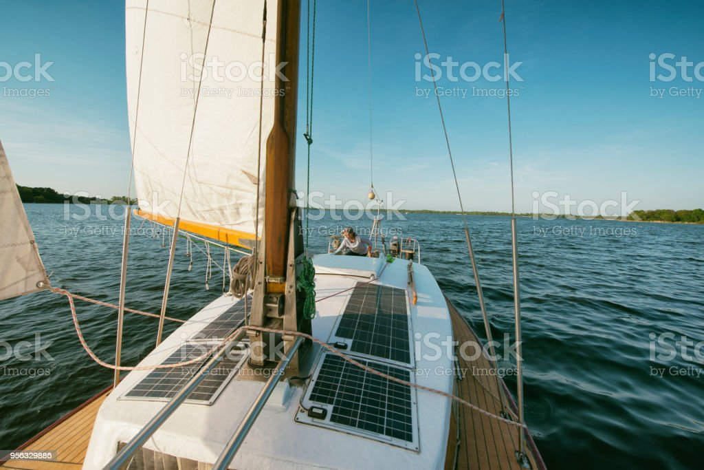 Yacht heeling, sailing at space wind course stock photo