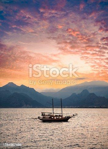 istock Yacht in Antalya Oldtown sunset view 1284967493