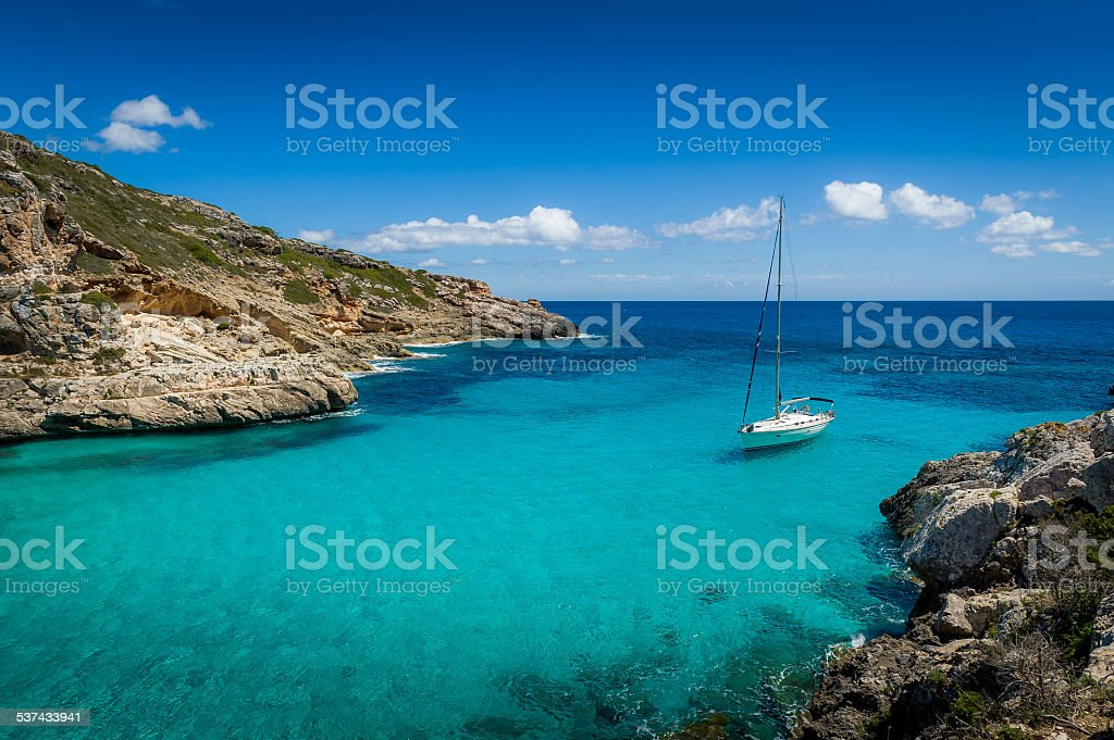 Yacht in dream bay stock photo