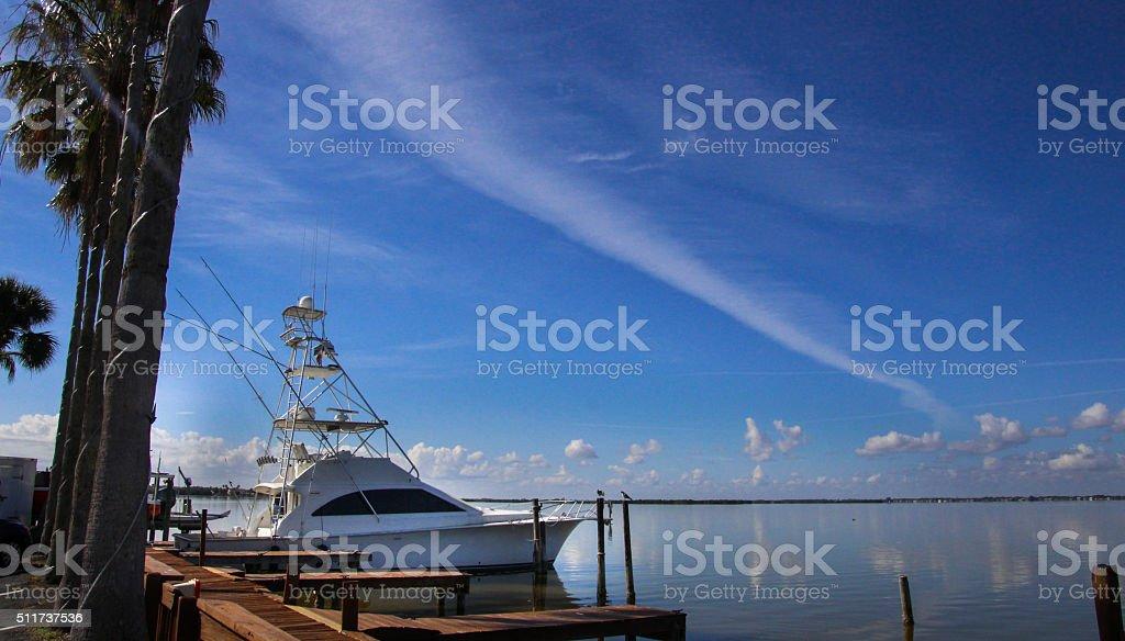 yacht in harbor stock photo