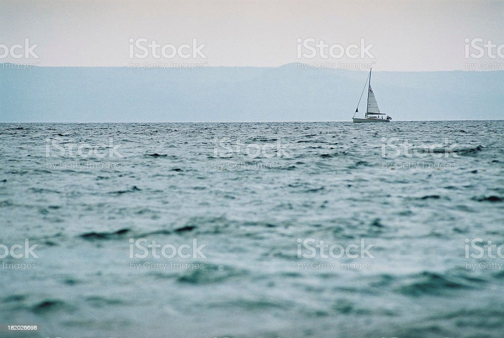 Yacht in stormy sea royalty-free stock photo