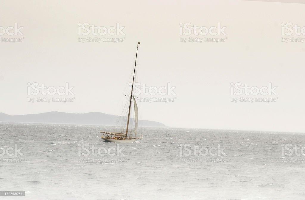 yacht in the fog stock photo