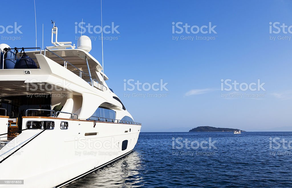 Yacht in the islands. Perfect shape. Summer sky. stock photo