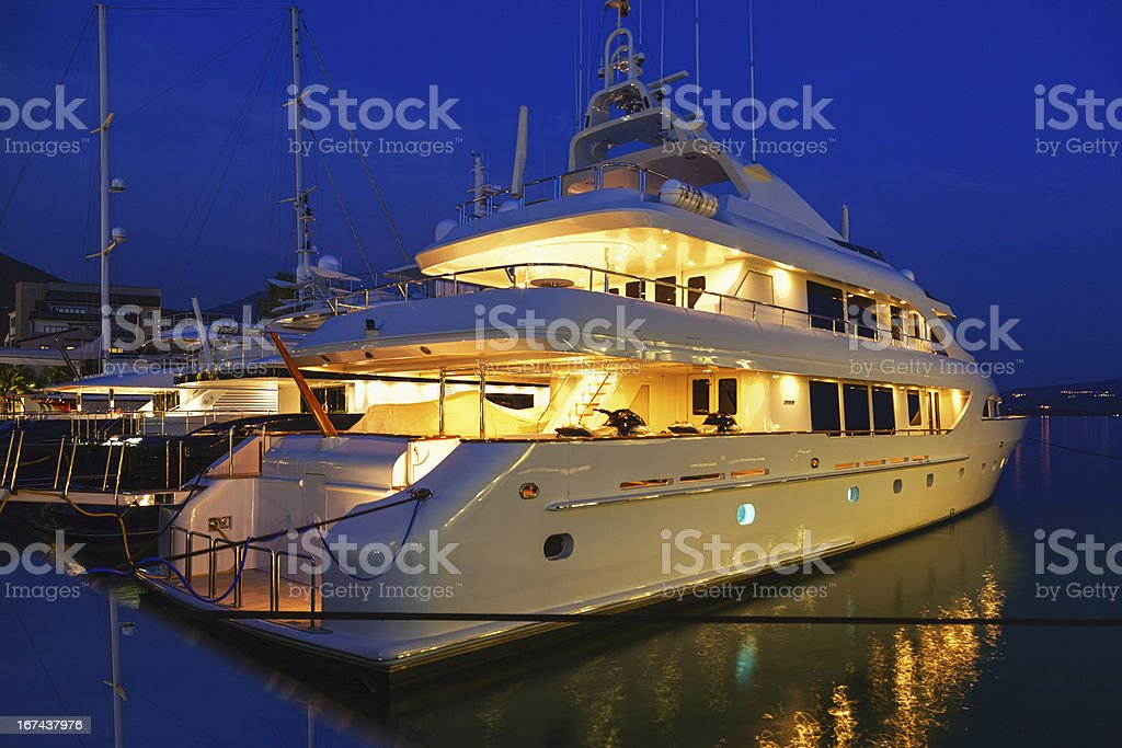 Yacht in the marina at night stock photo