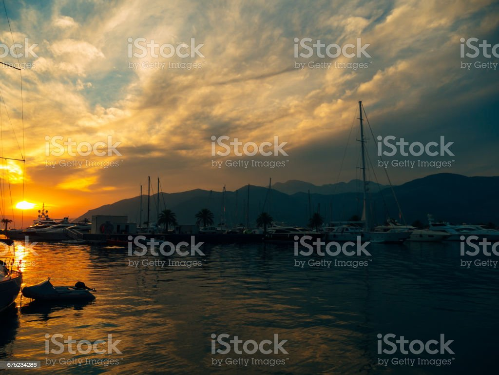 Yacht in the sea at sunset. Silhouette of a yacht on the backgro royalty-free stock photo