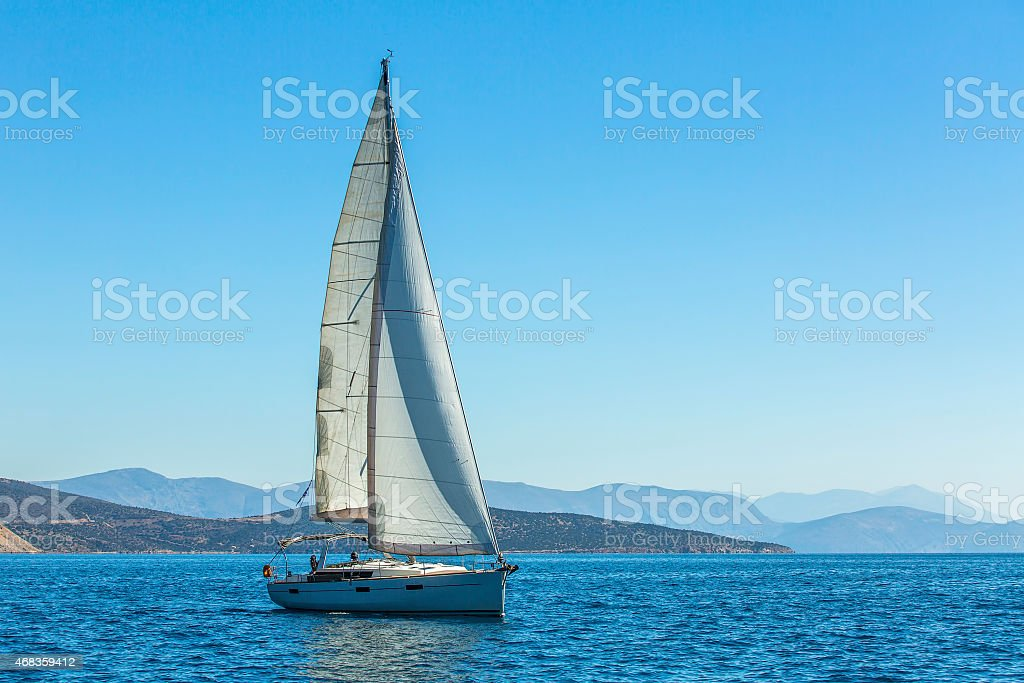 Yacht is moving along the coast. royalty-free stock photo