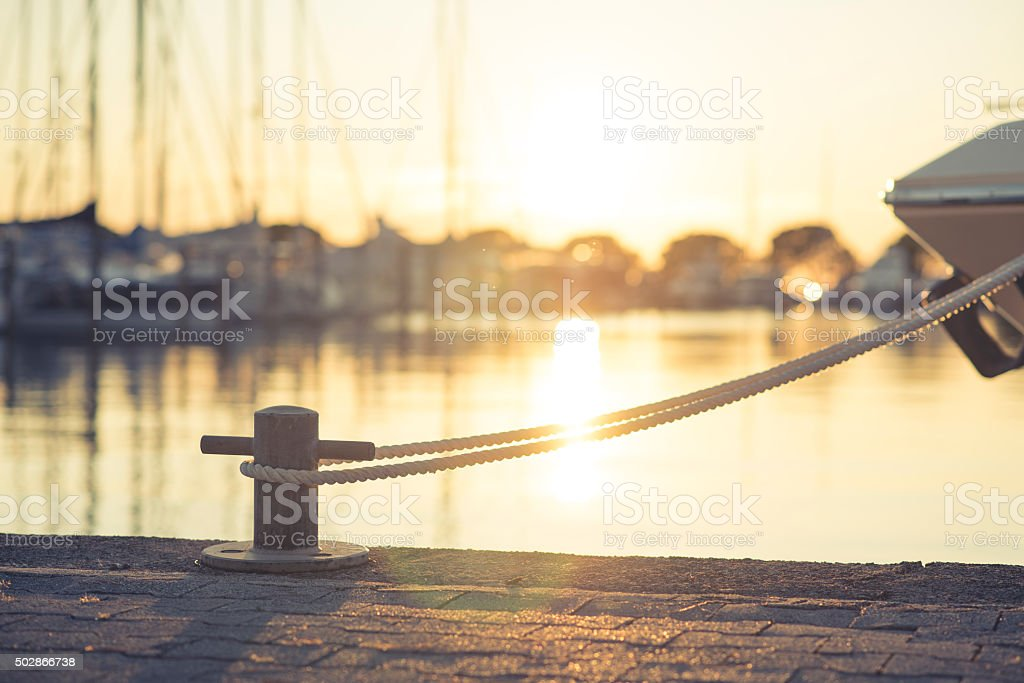 Yacht moored on harbour stock photo