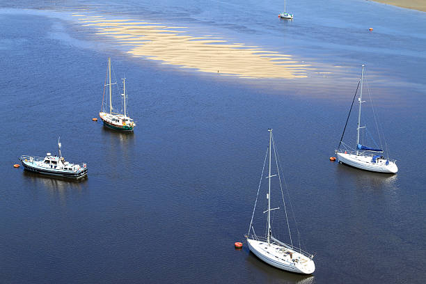 Yacht Moorings In Tidal Estuary stock photo